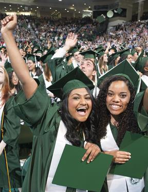 Picture of two students of color on graduation day.