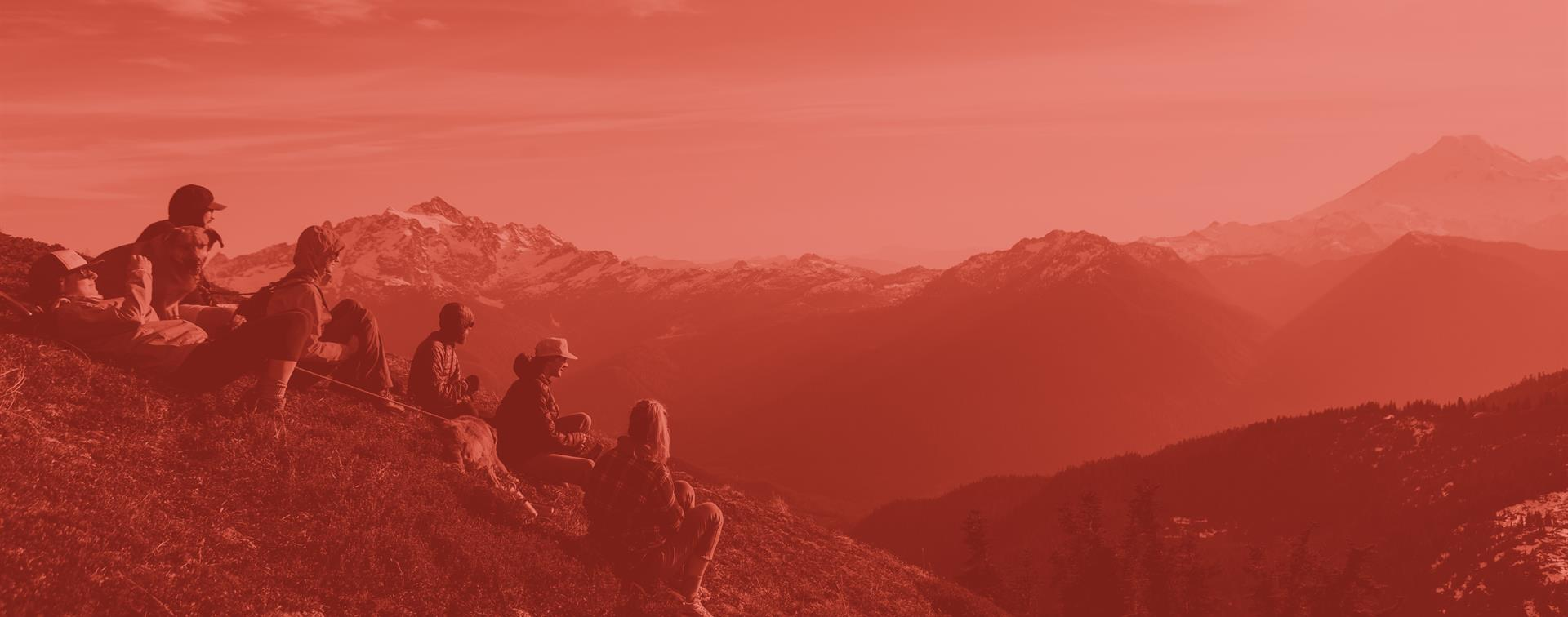 A picture of a group of students sitting on top of a mountain