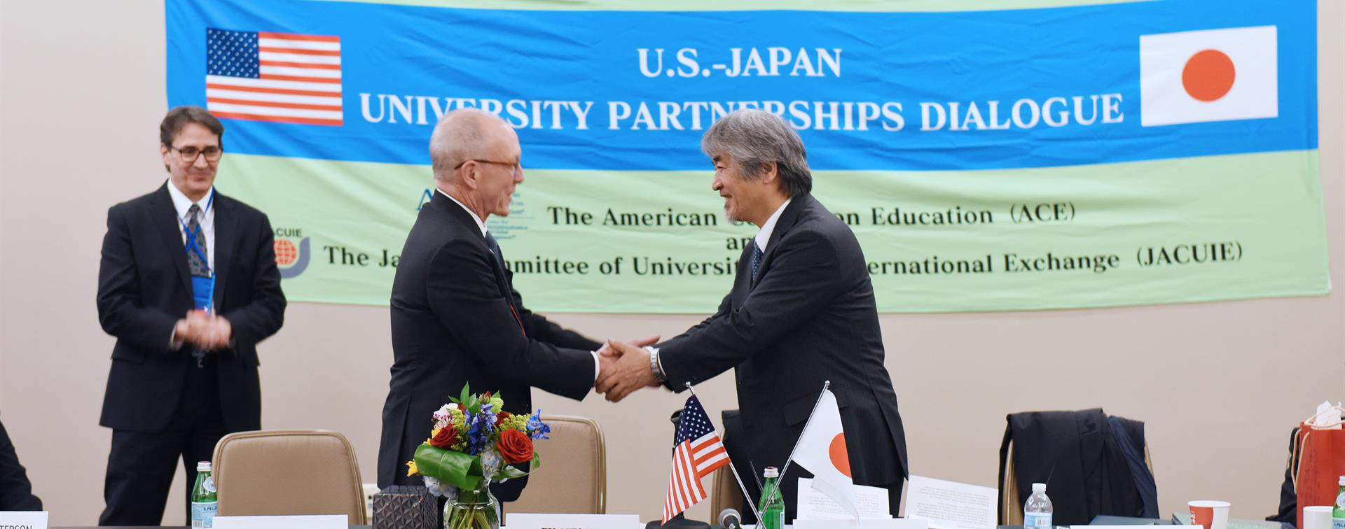 Picture of Ted Mitchell shaking hands with Juichi Yamagiwa.