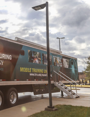 Tri-C's mobile training unit contains a classroom and customizable lab
