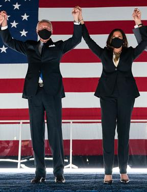 Picture of Joe Biden and Kamala Harris holding hands and raising them in the air.