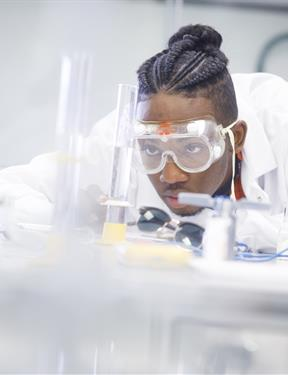Picture of student working in a lab at CUNY Stony Brook