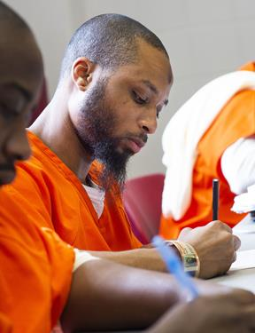 Photo of student in Georgetown Prison Scholars Program working at desk