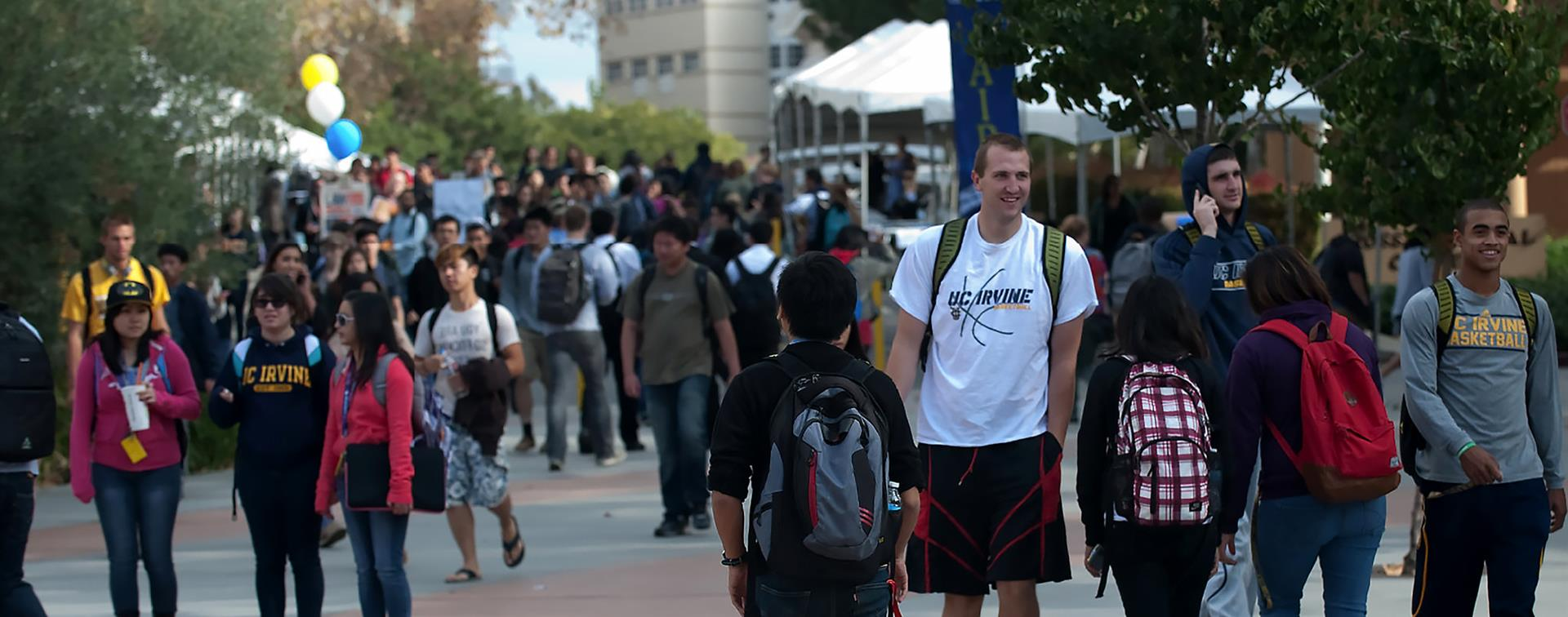 Picture of students milling on the Ring Mall at University of California, Irvine